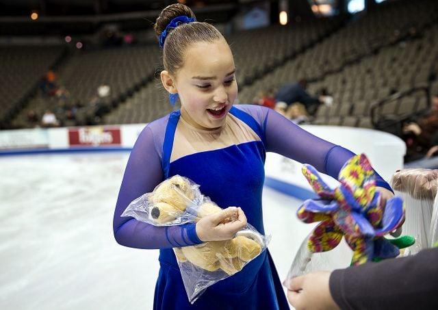 Hundreds of volunteers help keep figure skating championships running smoothly