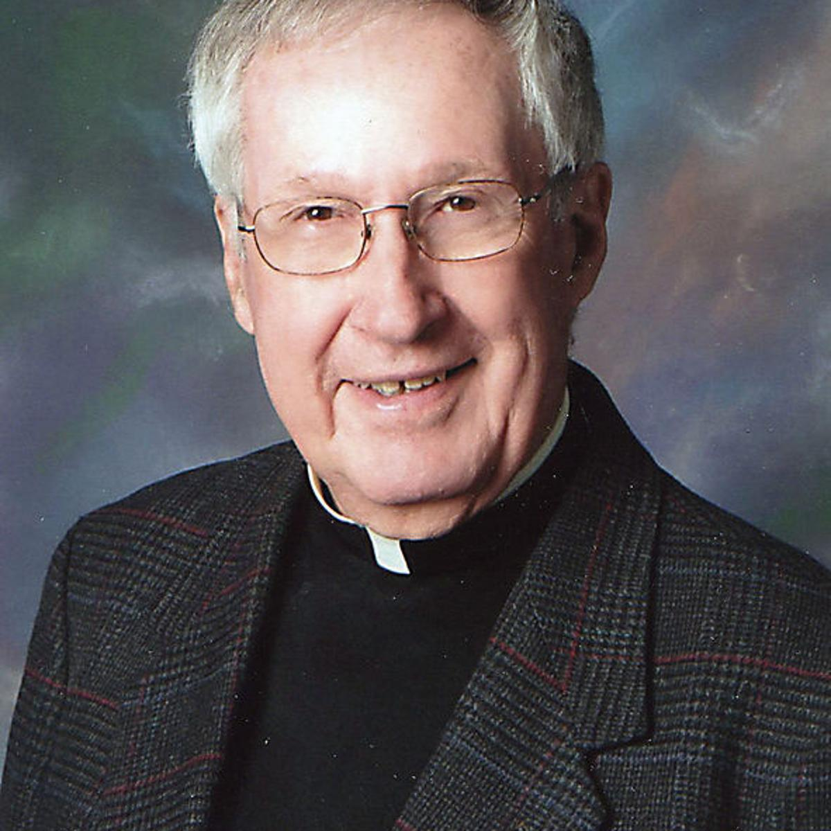 Retired Iowa priest charged with five counts of invasion of