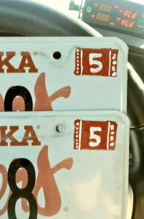 Nebraska driver cited for painting registration sticker on license plate