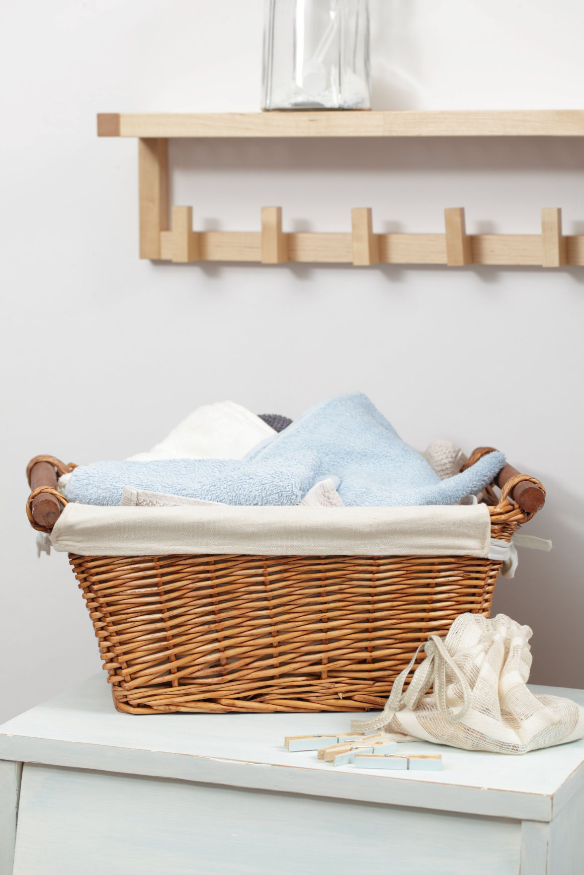 A high functioning laundry room should have a flat counter like area for folding and a stylish laundry basket for easy transportation to and from closets