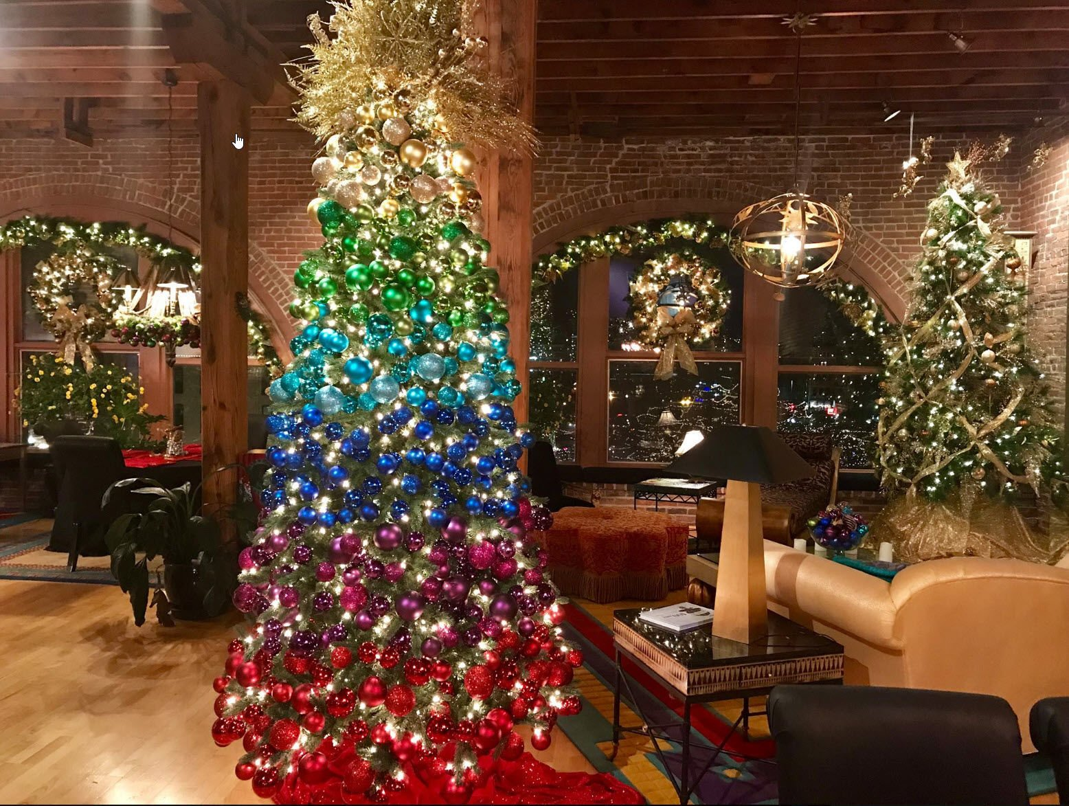 the tree starts with gold starburst and graduates to bulbs in shades of gold green turquoise royal blue purple and red - Royal Blue And Gold Christmas Decorations