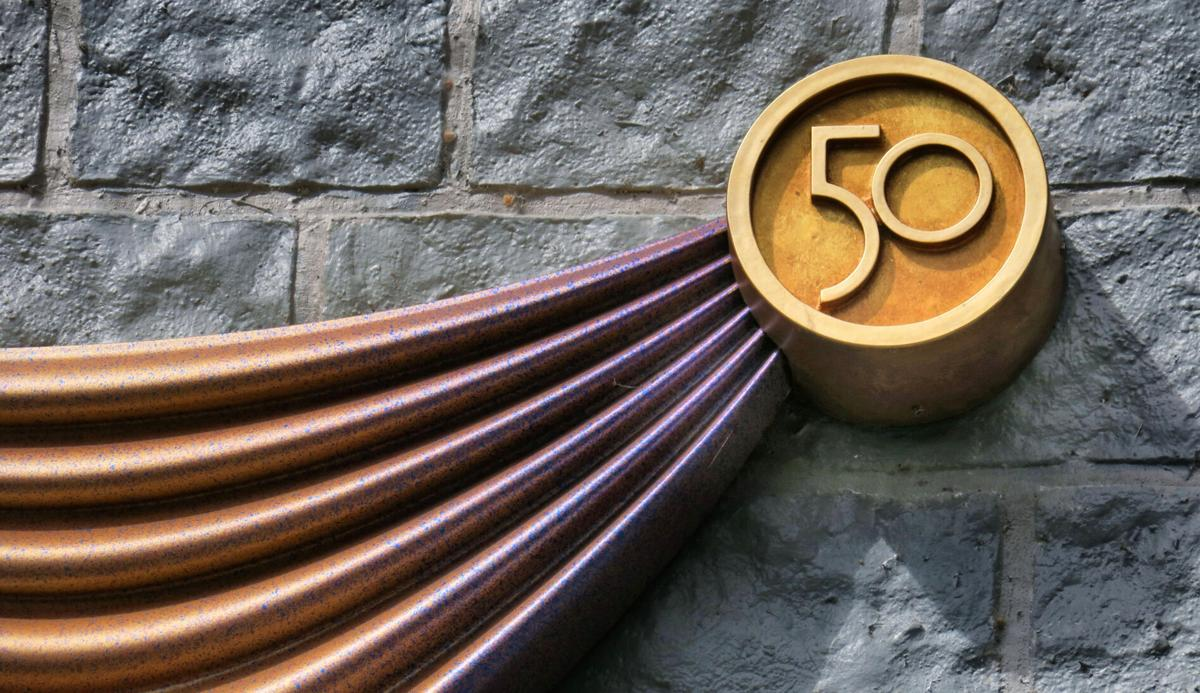 """A """"50"""" logo is built into the pin portion of the decorations being added to Cinderella Castle."""