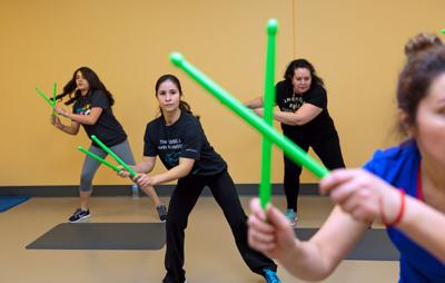 Excercisers beating a path to Pound Drum-inspired workout, complete with lime-green sticks, has been a hit for gyms By Katy Glover • World-Herald staff writer