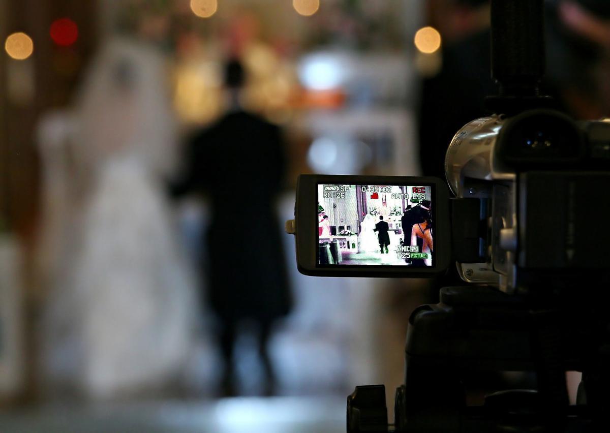 bride and groom on videotape