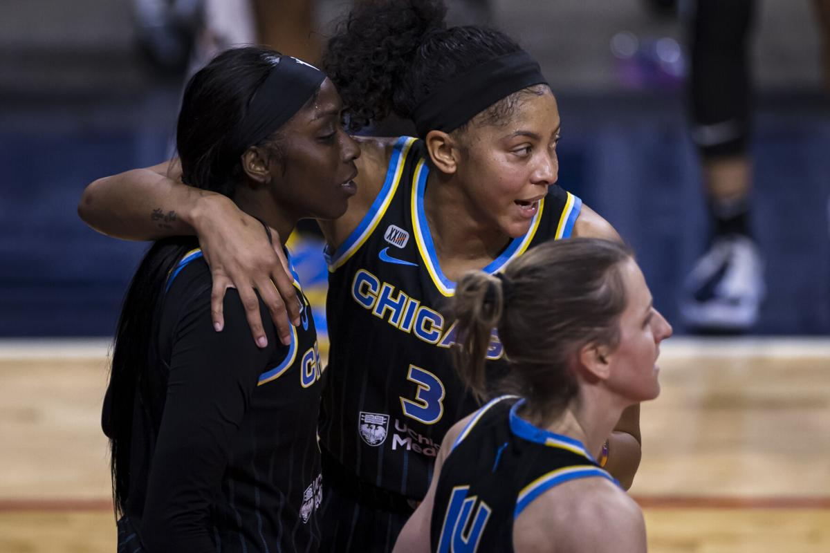 Candace Parker #3 of the Chicago Sky huddles with teammates Kahleah Copper #2 and Allie Quigley #14 during the first half of the game against the Washington Mystics at Entertainment and Sports Arena on May 15, 2021 in Washington, D.C..