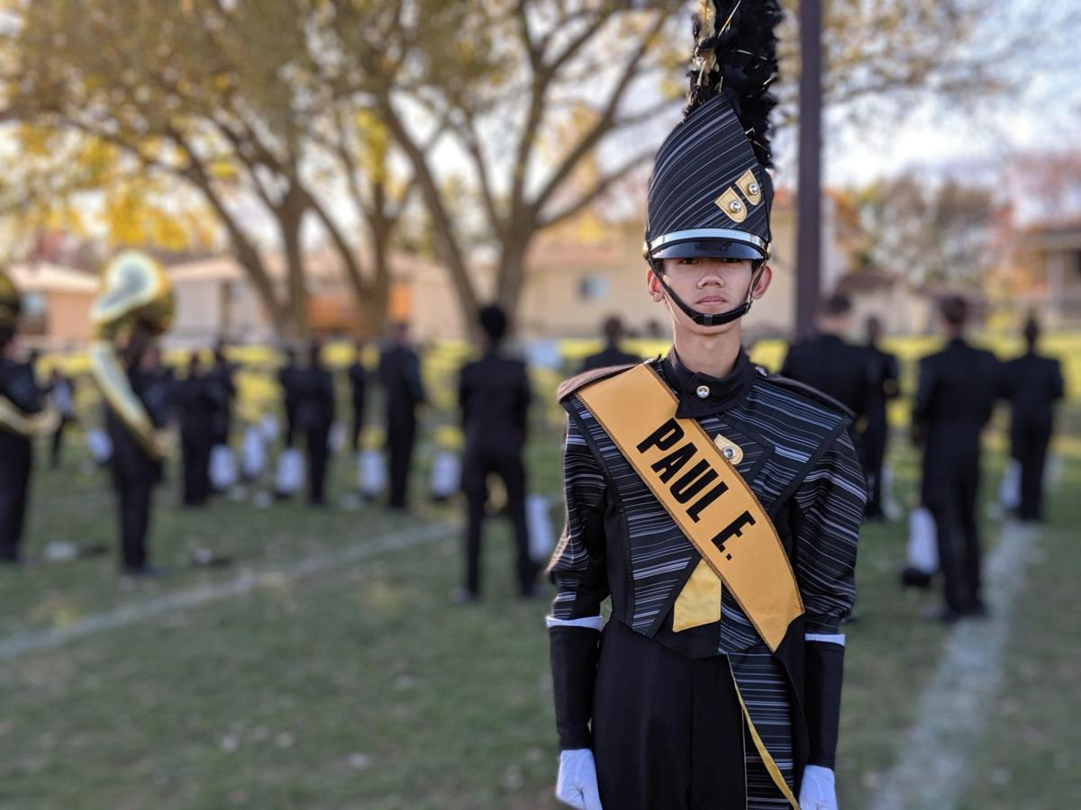 Burke High School drum major poses with 2019 band uniform