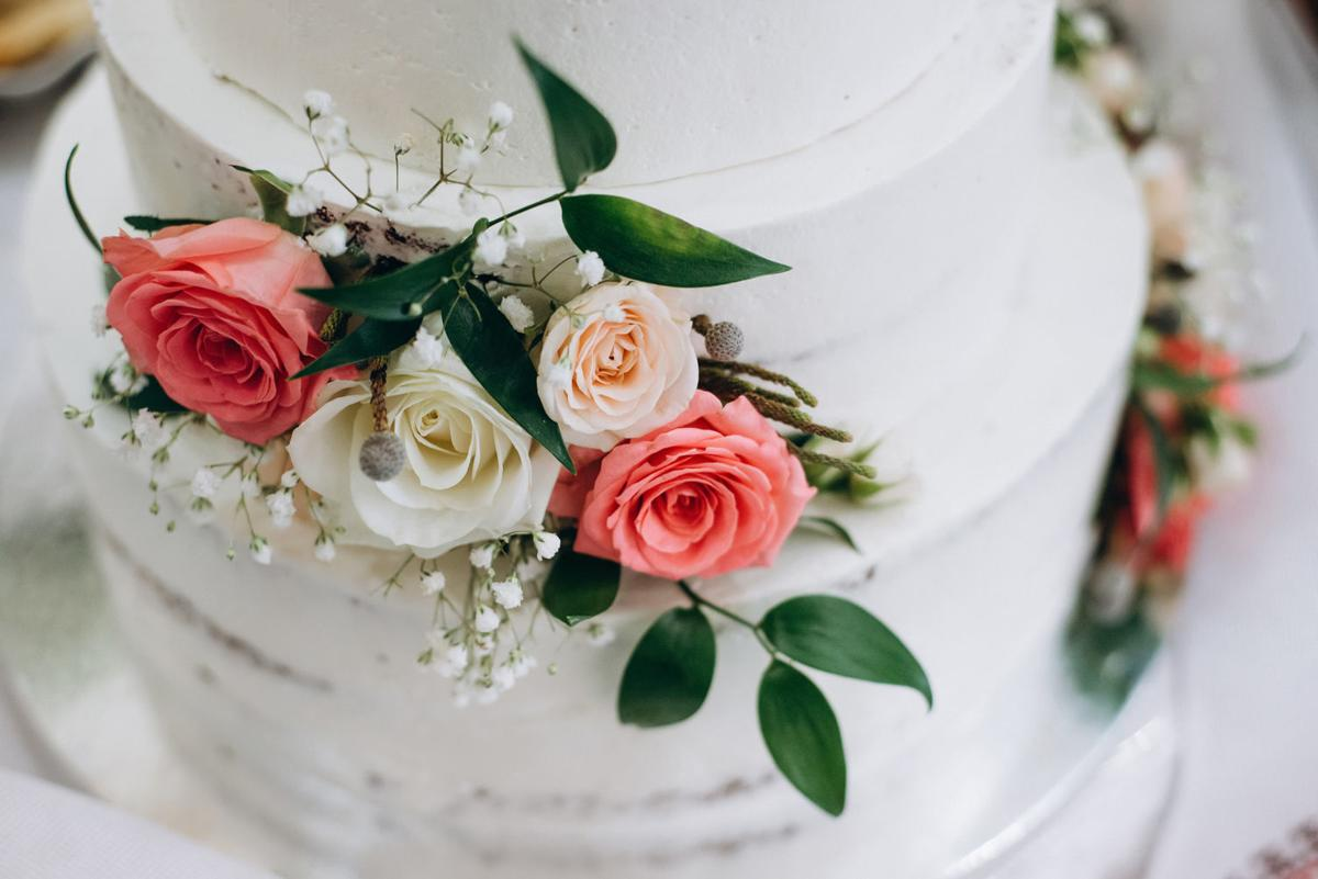 wedding cake with red and white flowers