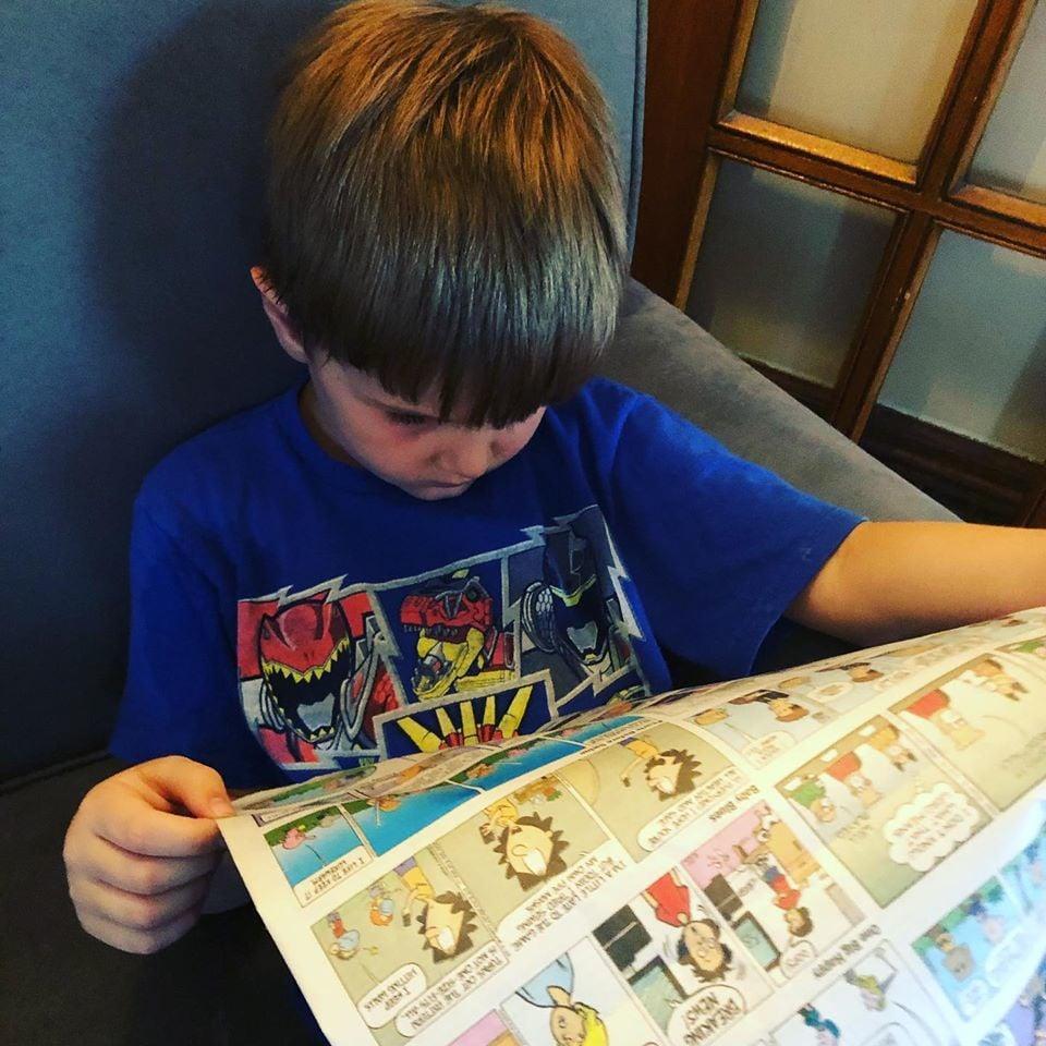Sam Coffey reading comics