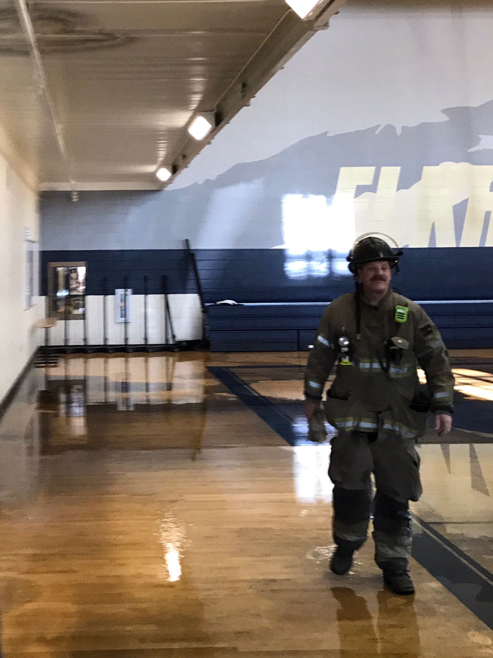 Thousands of gallons of water pour into Elkhorn South gym after wayward basketball shot snaps sprinkler