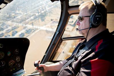 Kim Wolfe in in the Husker Helicopter