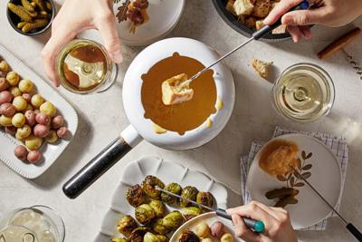 Fondue may feel retro, but sharing a pot of hot, melted cheese is timeless
