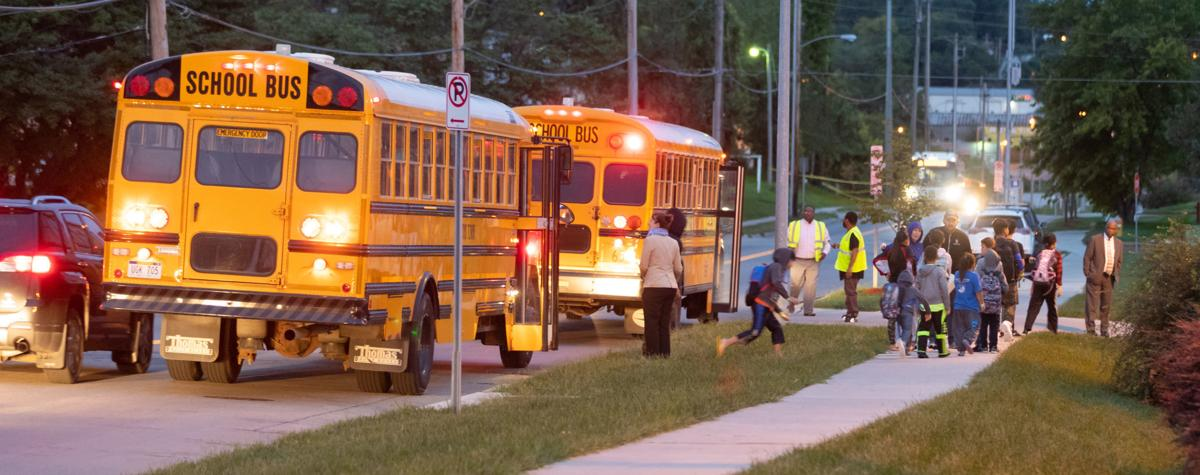 Kids take buses after being brought back near their homes