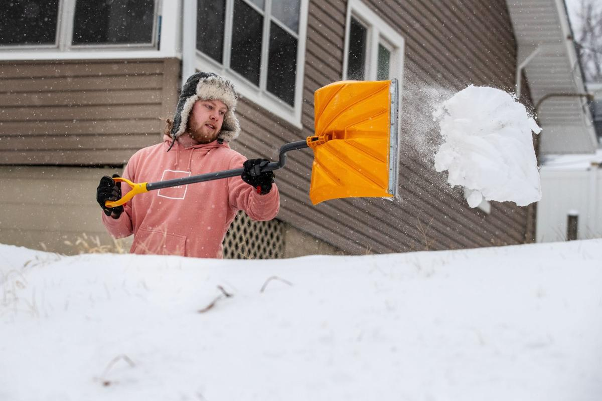 Taylor Hawkins shovels his driveway near 43rd and Leavenworth Streets on Friday.