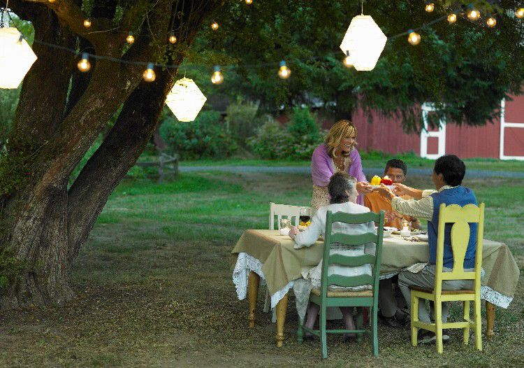 Outdoor lanterns and hanging lights add a soft glow to outdoor spaces.
