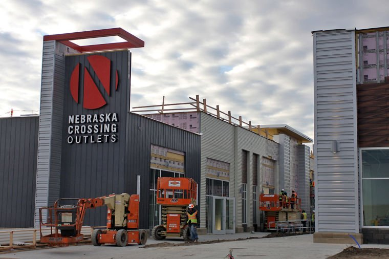 Nebraska Crossing Outlets. Task: Manufacture, deliver & install over Sunbrella fabric awnings for a high profile, fast track, ground up construction of the largest outlet mall in the Midwest.