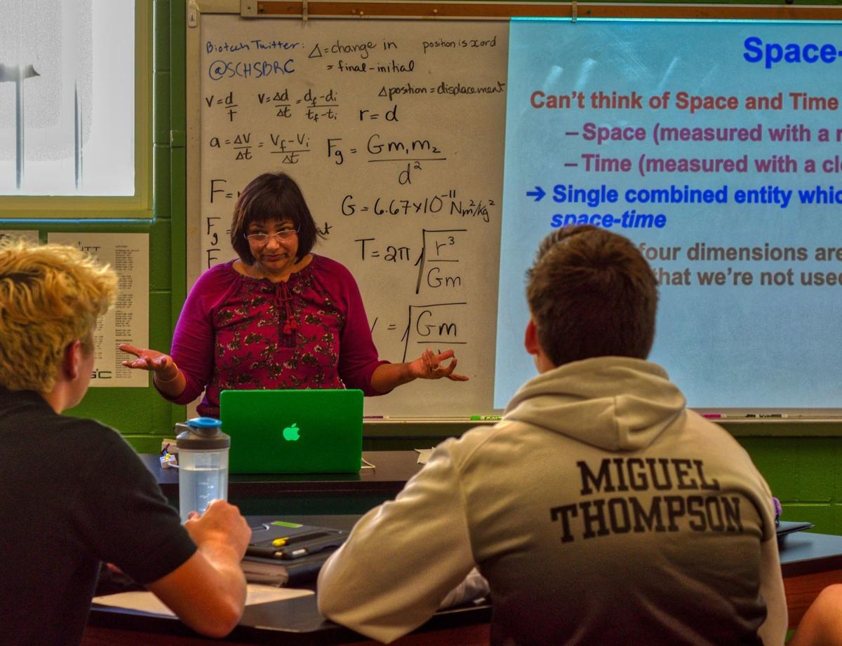 Skutt high science teacher Abbey Brockhouse engages physics students on Newton and Einstein