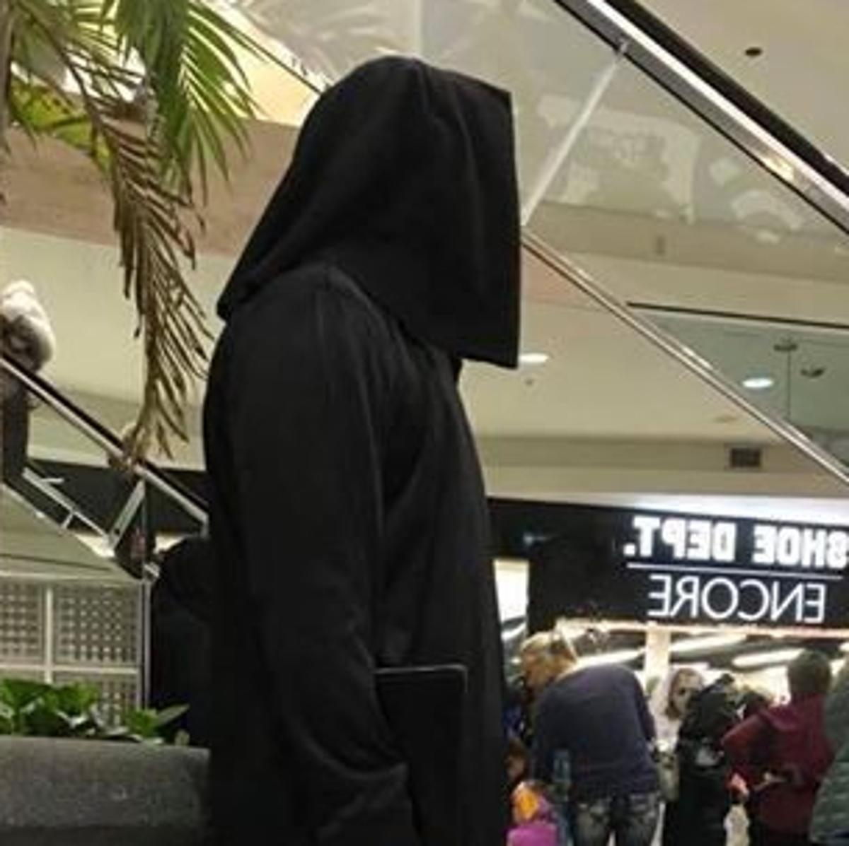 Photo of costumed person holding a gun at Oak View Mall