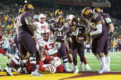 Physical Gophers pound Huskers on ground