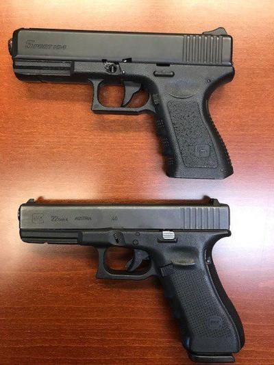 2 guns -- one fake, one real