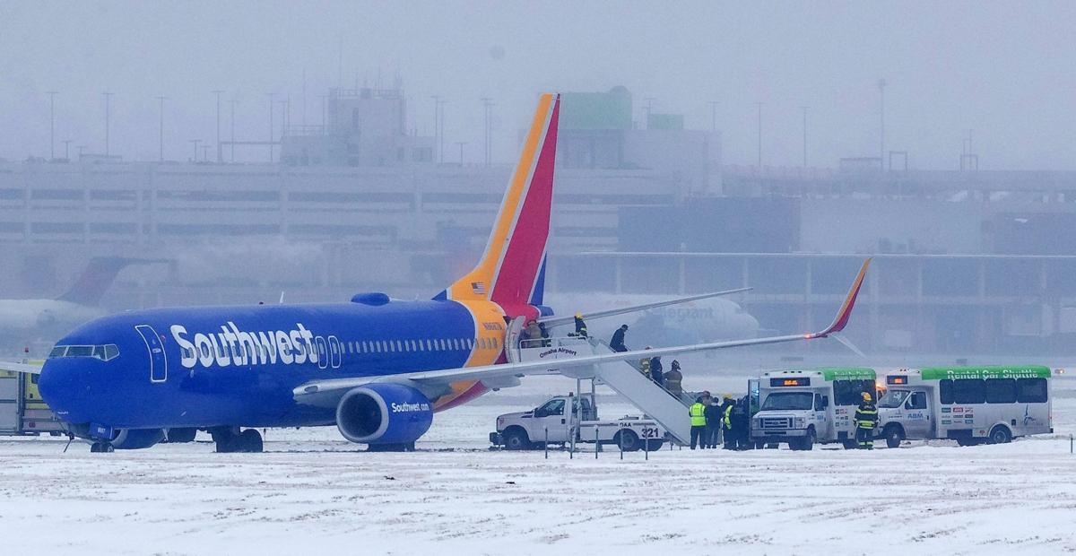 Omaha-bound plane slides off end of icy runway at Eppley; airport closed after incident