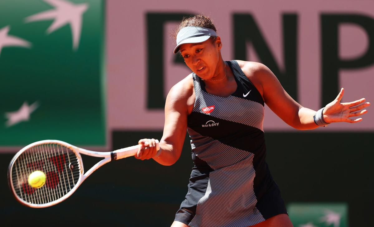 Naomi Osaka of Japan plays a forehand in her First Round match against Patricia Maria Tig of Romania during Day One of the 2021 French Open at Roland Garros on May 30, 2021 in Paris, France.