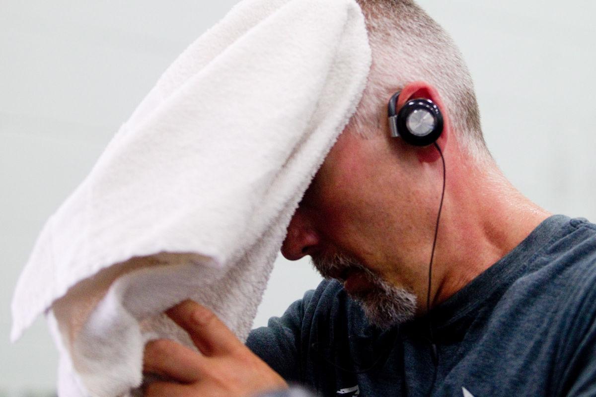 man sweats during workout 2