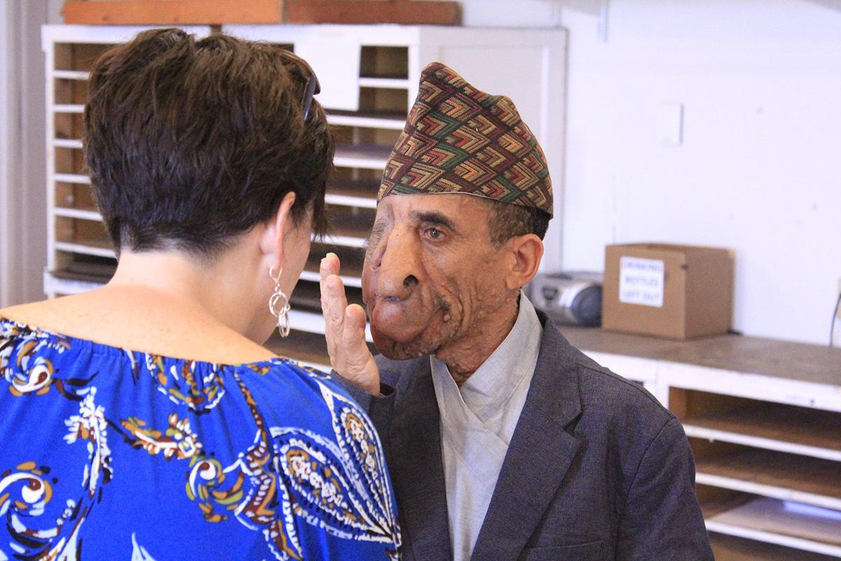 'Art ... is everywhere': Nepalese man gets new lease on life through art professor's portrait