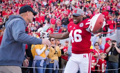 From the sidelines: All smiles for the Huskers during Senior Day ceremony