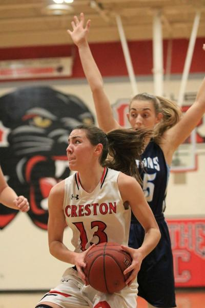 Creston junior Brielle Baker cooking as her teammates rise