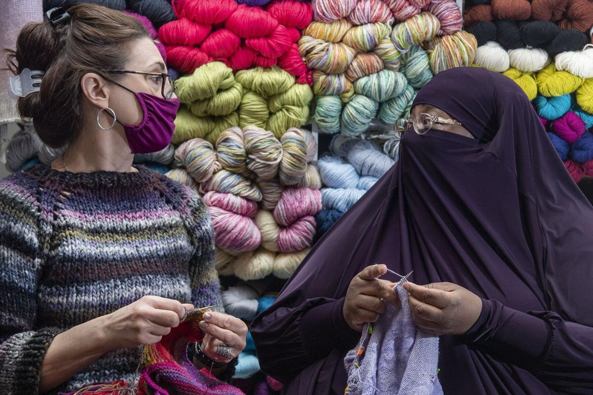 Ellen Rubin, left, and Yolanda Pressley knit together at Luv2Knit& More in Jenkintown, Pa..