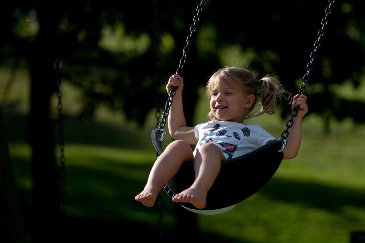 Girl swinging at park