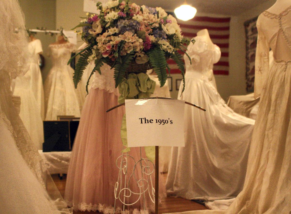 Wedding dresses tell the tales papillion times for Wedding dress display at home