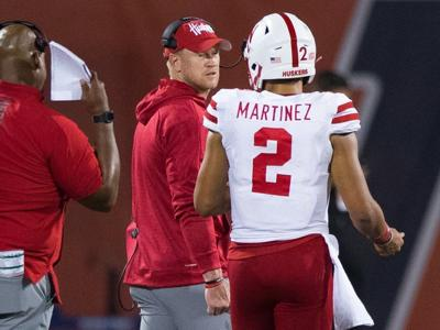 Scott Frost and Adrian Martinez