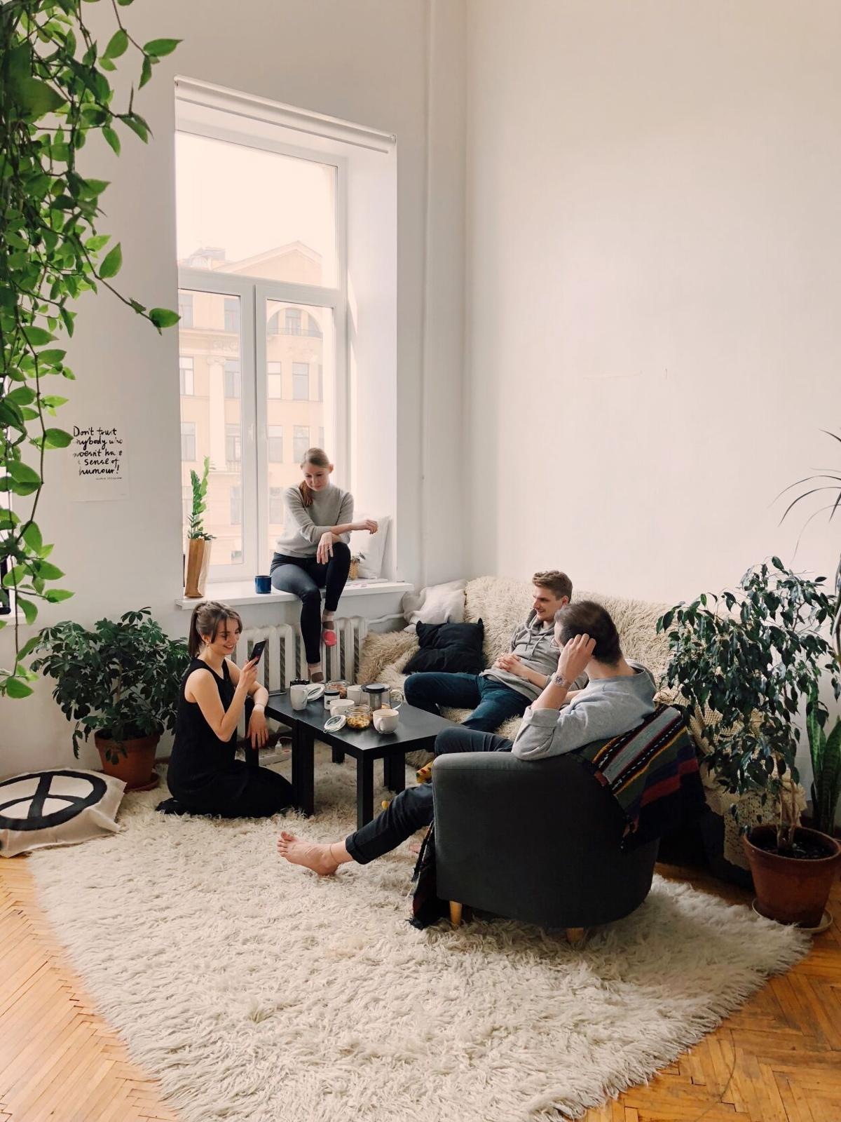 people-gathered-inside-house-sitting-on-sofa-1054974.jpg