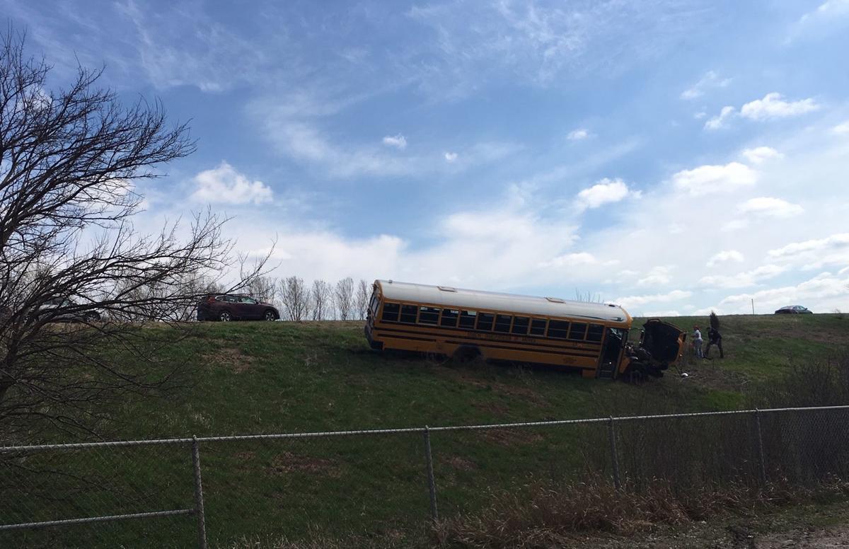 School bus comes to rest on embankment after fatal crash