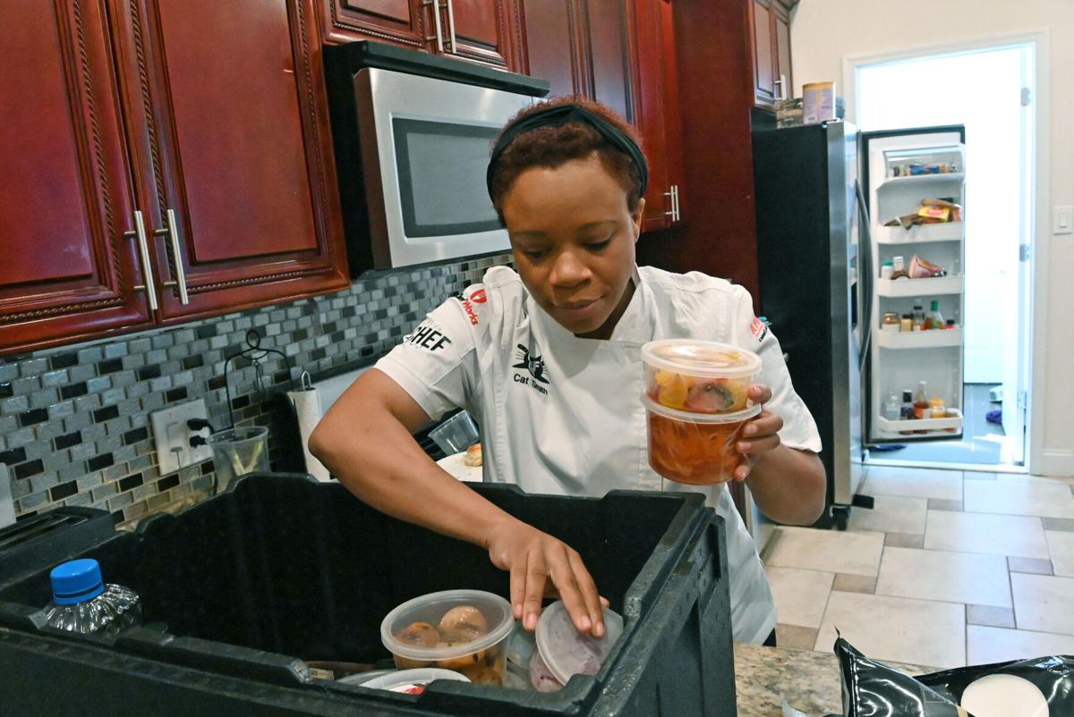 Catina Smith, founder of Just Call Me Chef, packs a dinner she is catering for clients two months after the birth of her third child, on Sept. 23, 2020.