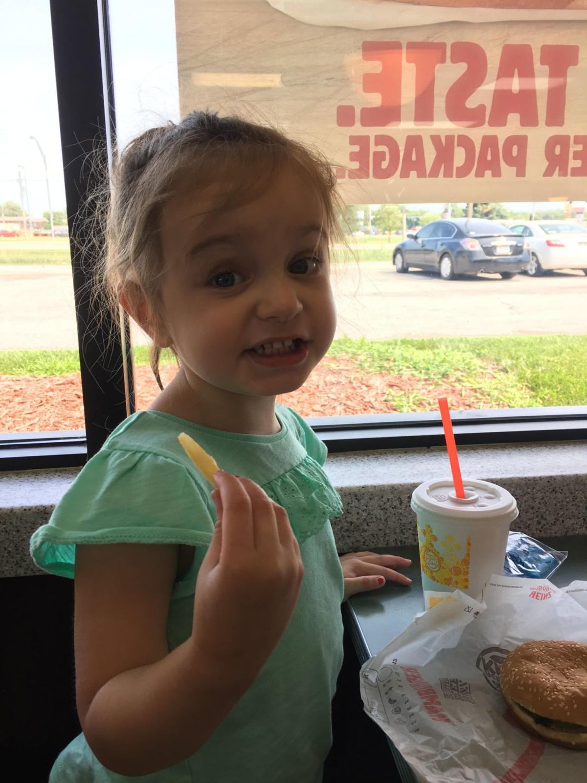 Kate Kirkle eating a hamburger