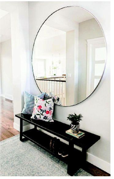 Decorate with mirrors without turning your home into a fiin house