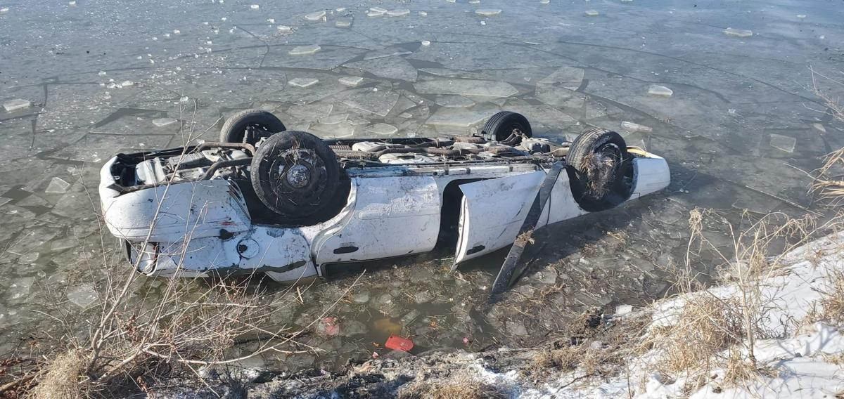 Three rescued from car that flipped into icy pond