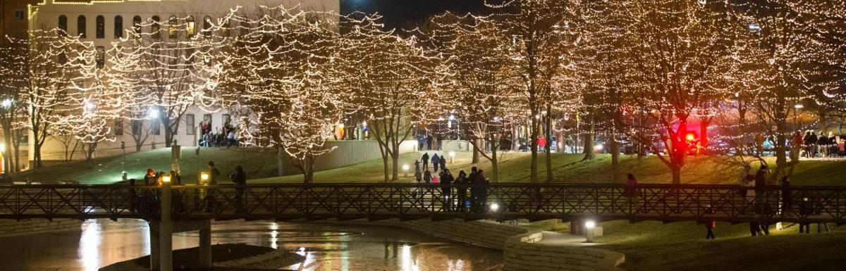 Spectators stroll the mall during the CenturyLink Thanksgiving Lighting Ceremony at the Holiday Lights Festival on Thursday. The lights will stay on until ...