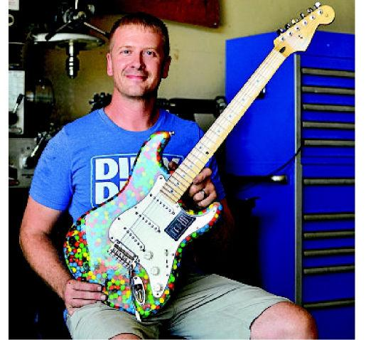 Norfolk man builds sweet guitar to the tune of 4,000 little candies