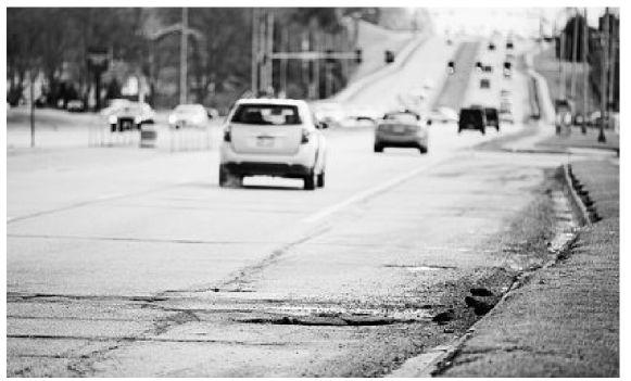 Stothert seeks input on lasting street fixes, how to pay for them
