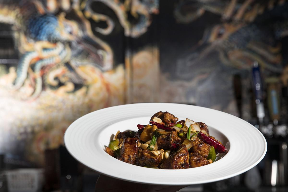 ASIAN FUSION WORTH REVISITING O Dining is refreshed and reopened for good downtown