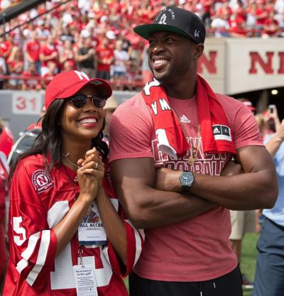 From the sidelines: D-Wade and wife Gabrielle appear; Tunnel Walk tweaks