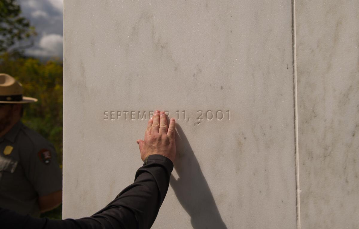 A visitor traces the date etched in a marble slab on the Wall of Names at the Flight 93 National Memorial before the 15th Anniversary of the September 11 terrorist attacks, September 11, 2016 in Shanksville, Pennsylvania.