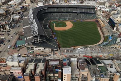 Cubs owner Ricketts buys Wrigley rooftop buildings