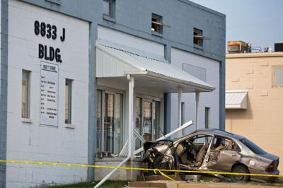 Speeding car didn't slow before hitting building, killing two