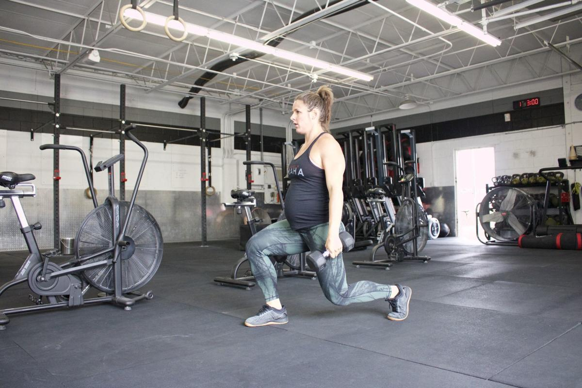 Stacie Tovar works out while pregnant