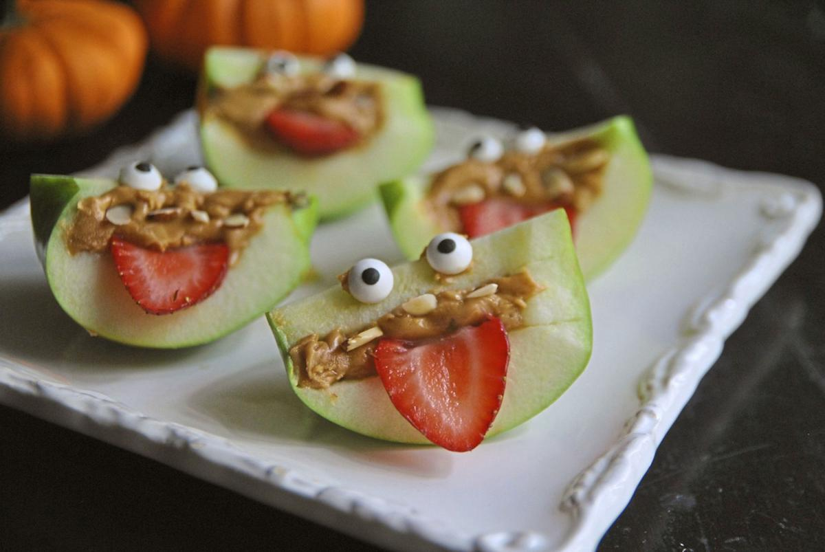 Turn apple wedges into spooky, silly and healthful apple monsters with almond teeth and sliced strawberry eyes.