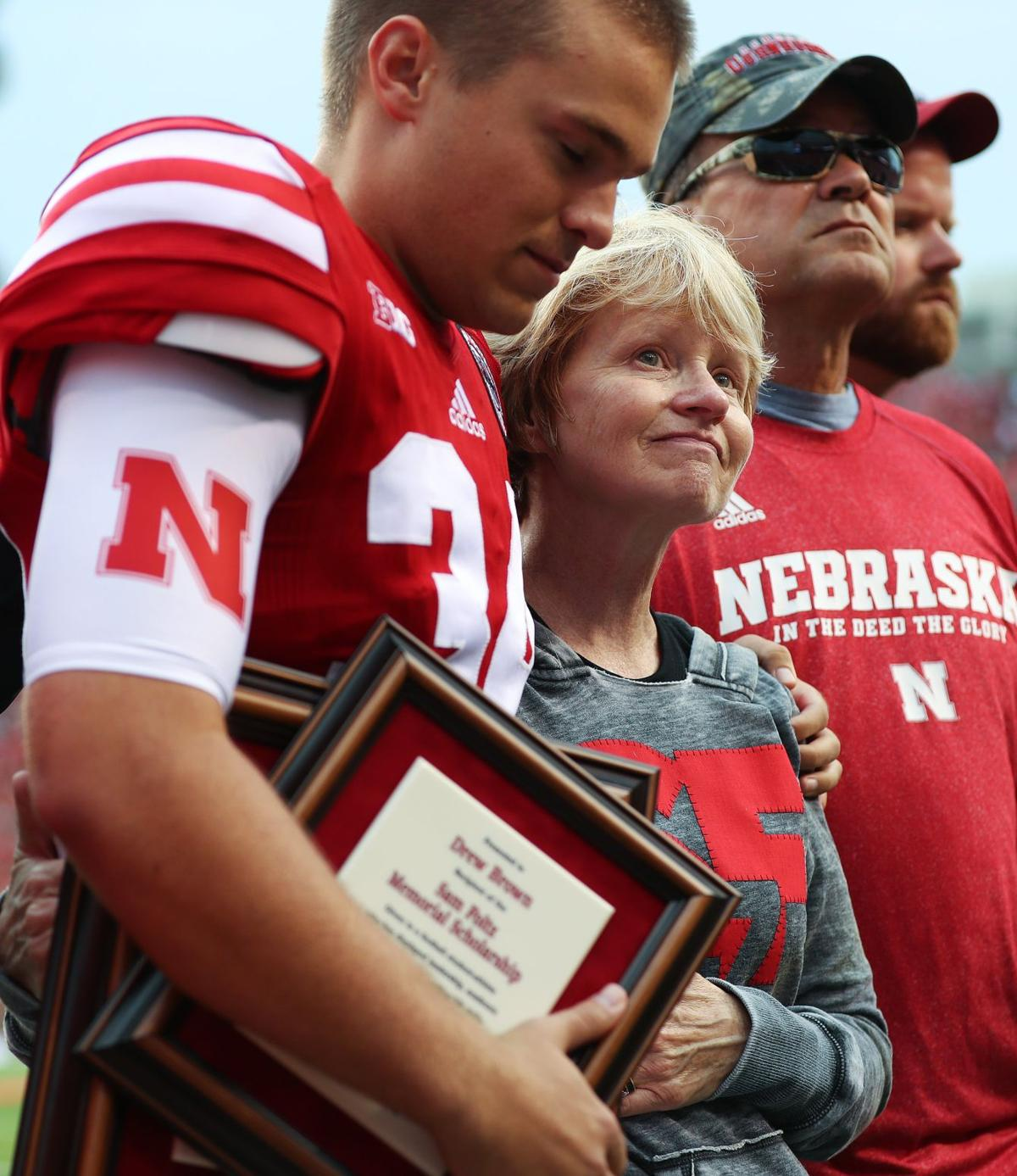 Sam Foltz's family and Nebraska teammates give one another a lift